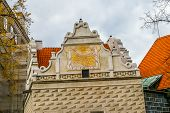 pic of sundial  - View on sundial and red roofs in Cesky Krumlov Czech Republic - JPG