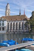 stock photo of zurich  - Zurich Switzerland - the Limmat river the Water Church and the Grossmunster towers in the background.
