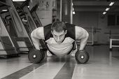 stock photo of lifting-off  - Man doing workout with heavy dumbbell - JPG