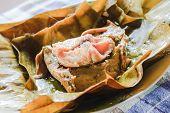stock photo of gai  - steamed fish curry custard in banana leaf - JPG