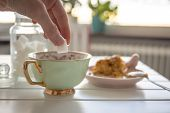 stock photo of sugar cube  - Morning tea with dessert and woman - JPG