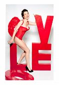 picture of cupid  - Female cupid in red corset with love word inscription - JPG