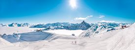 pic of winter sport  - Panorama of Mountain Range winter Landscape with Blue Sky and skiing slopes at Meribel Skiing Resort in French Alps - JPG