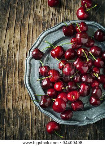 Sweet Cherries On Vintage Plate.