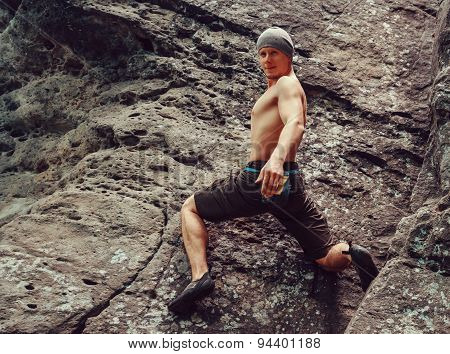 Young Man Climbing On Stone Rock, Bouldering