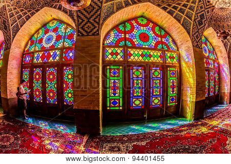 Tourists in the Nasir Al-Mulk Mosque by the windows