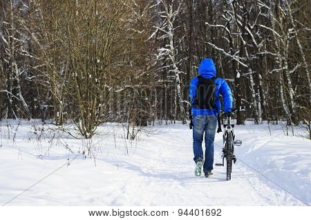 Walking winter cyclist