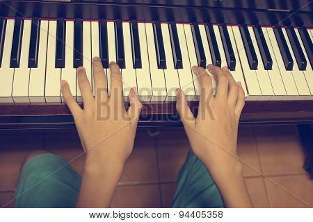 Girl's hands on the keyboard of the piano : Vintage filter