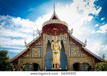 Golden statue in front of a Chiang Mai temple, Thailand