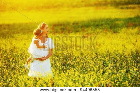 Happy Family In Summer Meadow, Mother And Little Daughter Child