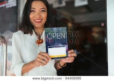 Holding open sign
