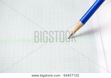 Close-up Blue Pencil On Graph Paper Background