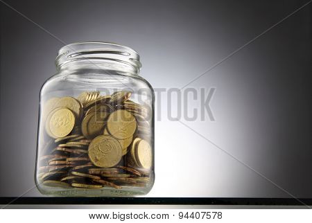money or coins in the saving jar