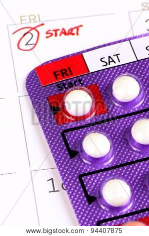 Colorful oral contraceptive pill.