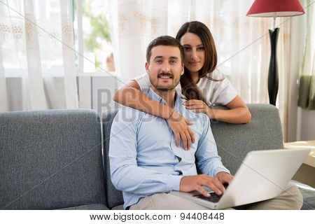 Loving couple with a laptop