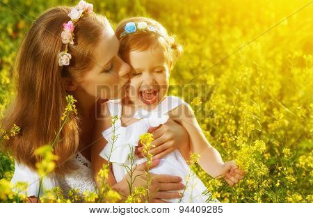 Happy Family In Summer Meadow, Mother Kissing Little Daughter Child