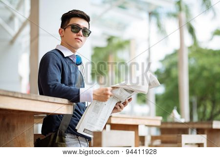 Young man with a newspaper