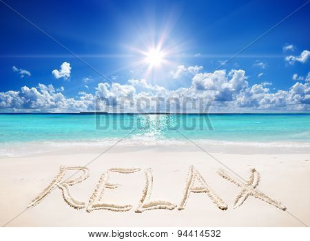 written relax on sand of the tropical beach with sun