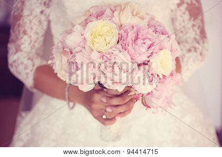 Hands Of A Bride Holding Peonies Bouquet