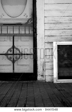 Screen Door and Porch of Old Home