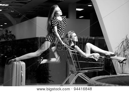 Aluring Girls With Shopping Trolley
