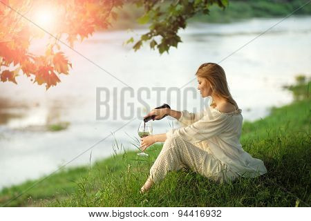 Pretty Woman In Sunset Near River