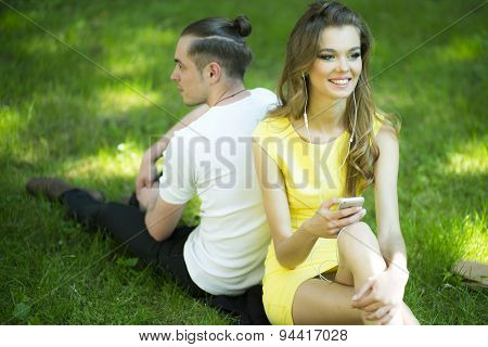 Smiling Girl And Boy On Green Grass