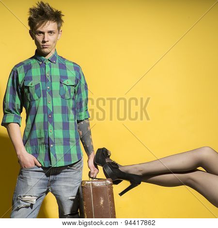 Handsome Man With Suitcasen Amd Female Legs
