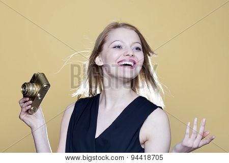 Woman With Retro Photo Camera