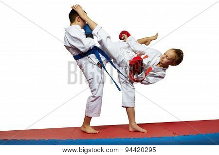 Boy and girl in karategi beats kicks