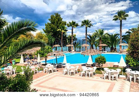 Palms and swimming pool in Corfu