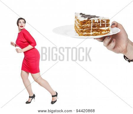 Diet And Nutrition Concept. Plus Size Woman Afraid Cake