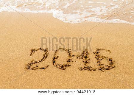 2016 Year written on sand tropical beach.