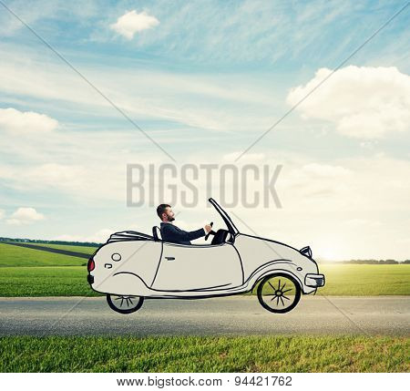 smiley man sitting in drawing car and driving on the road over beautiful landscape with blue sky and green fields