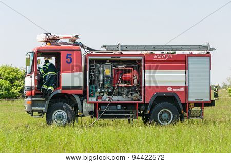 BORYSPIL, UKRAINE - MAY, 20, 2015: Red firetruck Mercedes Benz ride on call fire suppression and min