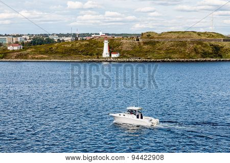 White Yacht Past White Halifax Lighthouse