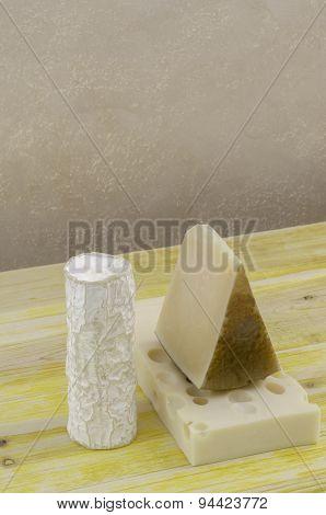 Spanish Manchego Cheese, Goat Cheese And Gruyere.