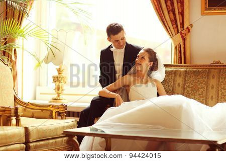 Bride And Groom On Sofa