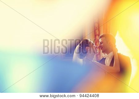Bride And Groom In Colorful Atmosphere