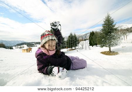Young Girl Play With Snow In The Mountains In Winter