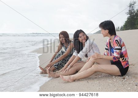 Portrait Of Young Beautiful Asian Woman Relaxing And Talking With Happiness Emotion On Sea Beach In