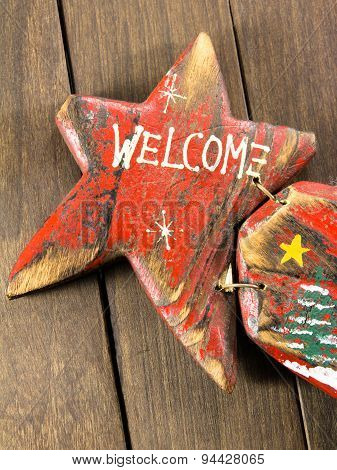 Red Wooden Decoration Comet Star Shaped On Wooden Background