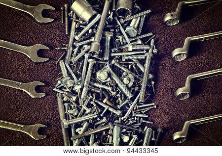 Group of screws and wrenches.