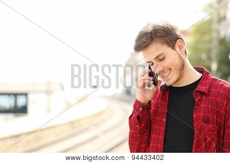Teen Guy Calling On The Mobile Phone Waiting A Train