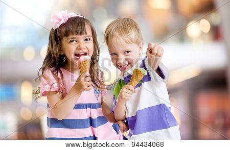 happy kids eating ice cream on nice bokeh background