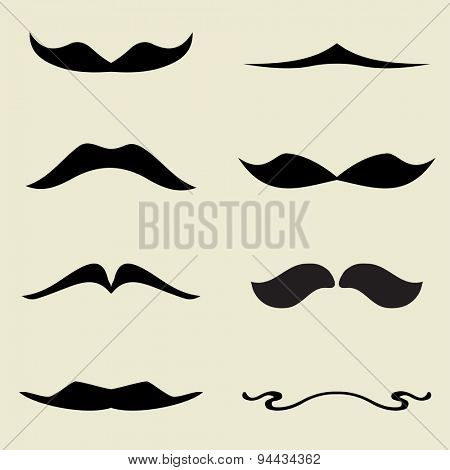 Set of retro black mustaches on beige background