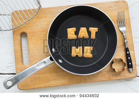 Letter Biscuits Word Eat Me And Cooking Equipments.