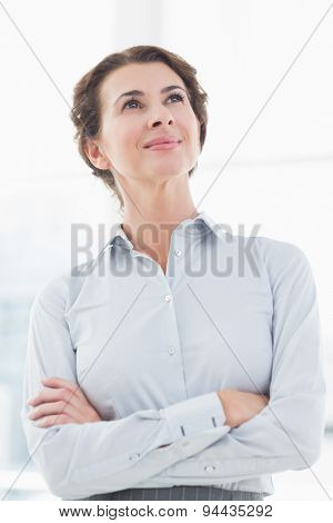 Thoughtful businesswoman looking away in her office