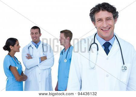 Doctors and nurses with arms crossed discussing on a white background