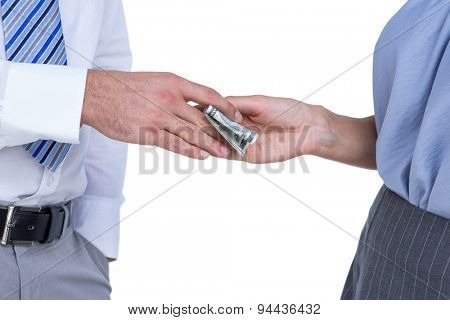 Businessman giving bank notes to his colleague on white background